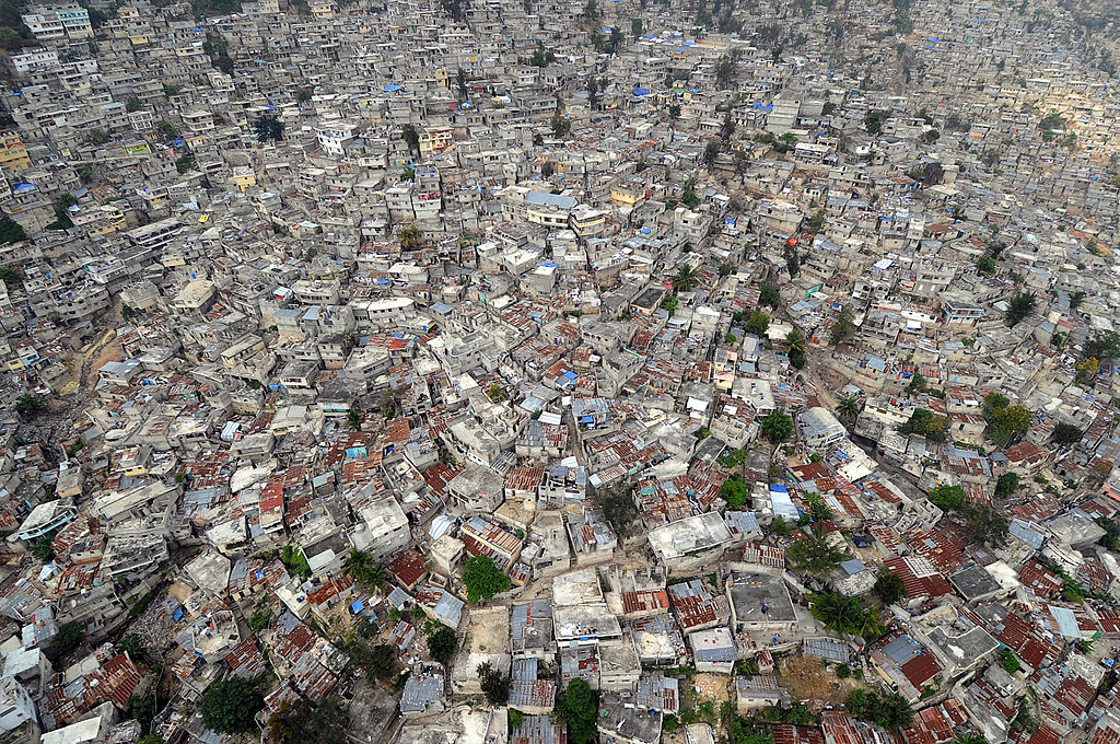 An aerial view of Port-au-Prince. Over half of the city's population has migrated from elsewhere in the country. U.S. Navy photo by Senior Chief Mass Communication Specialist Spike Call [Public domain], via Wikimedia Commons