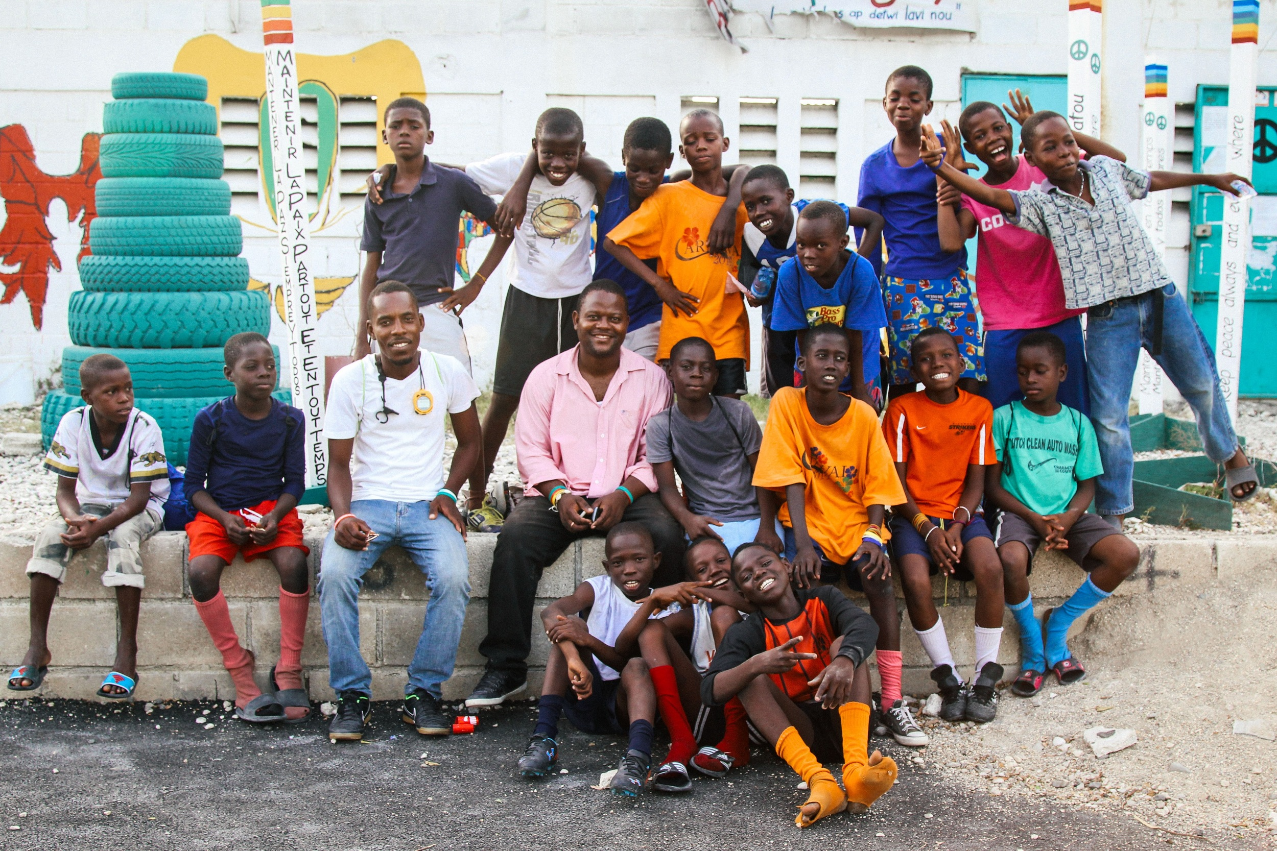 Both teams pose at the end of practice with Coach Fils-Aimé and Felder Jean Paul (at center), one of the members of SAKALA's leadership.