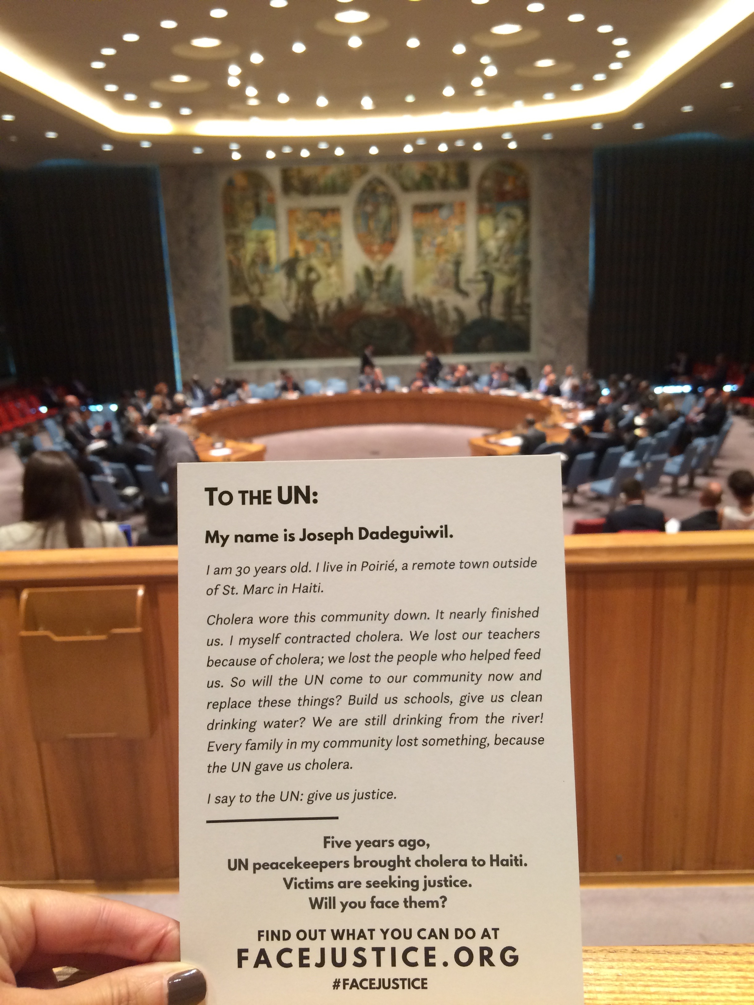 A cholera victims' testimony within the UN Security Council chamber. Bea Lindstrom.