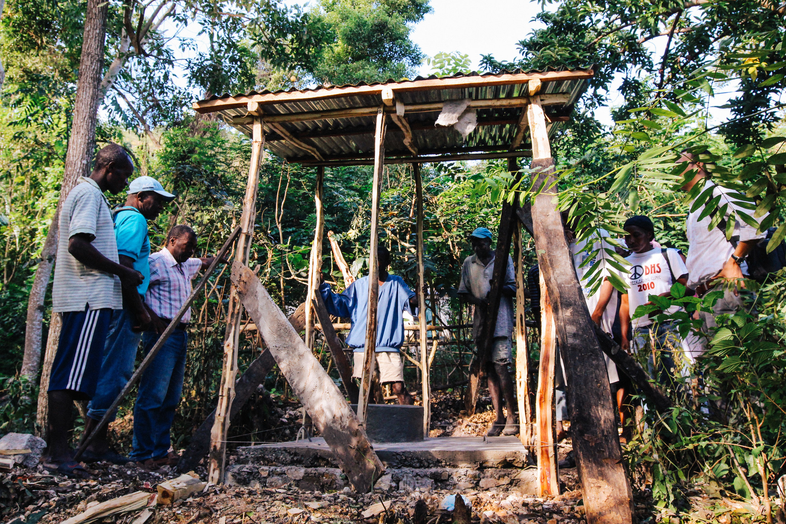 The first latrine in the community is nearing completion.