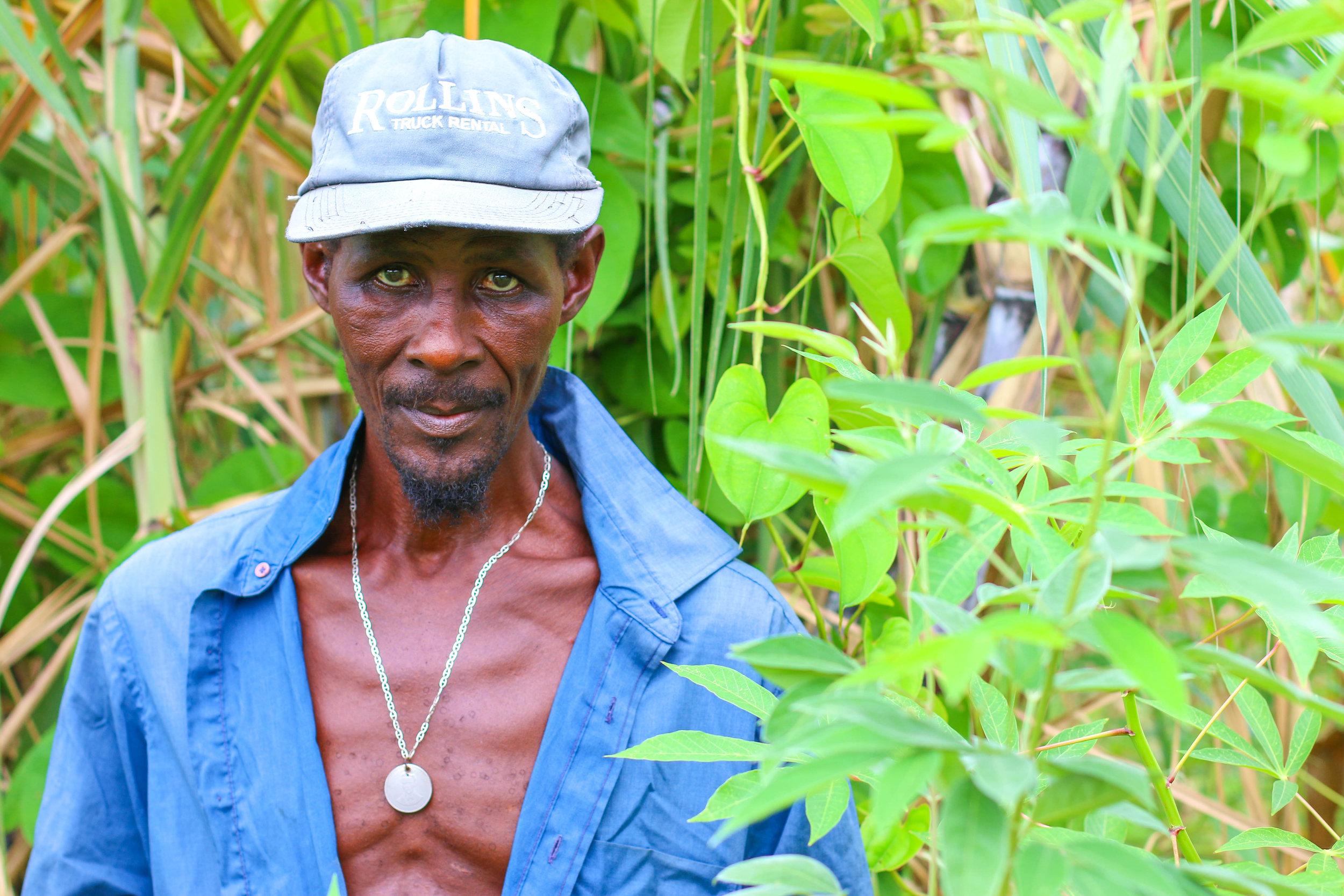 Judiuc Lundi, better known as Ti Mango, in his garden in Kabay, Haiti. Photo/Annalee Giesbrecht.