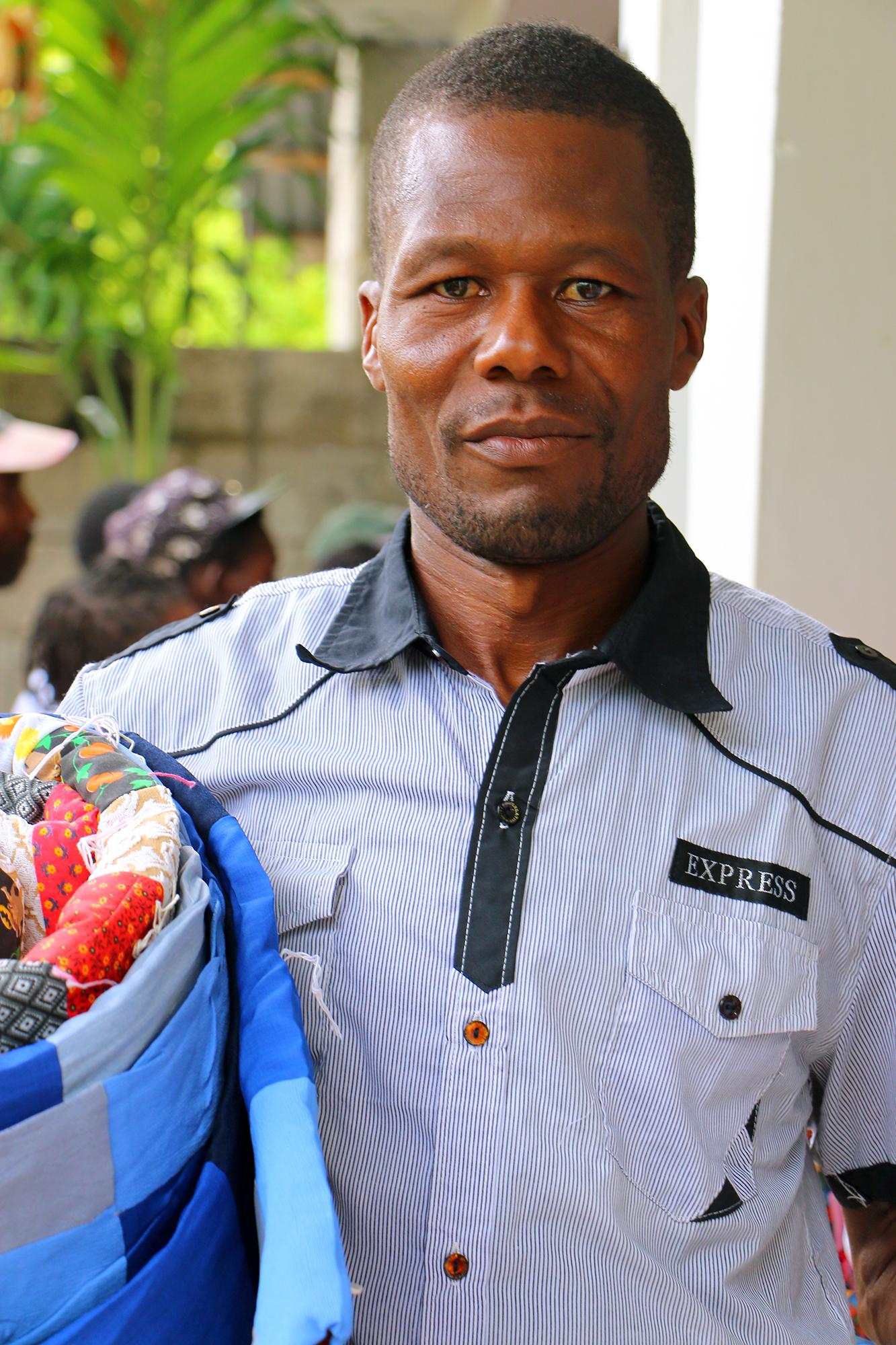 Bosto Poco receives MCC material aid in La Chapelle,Haiti, after Hurricane Irma struck the region in September, 2017. MCC Photo/Annalee Giesbrecht