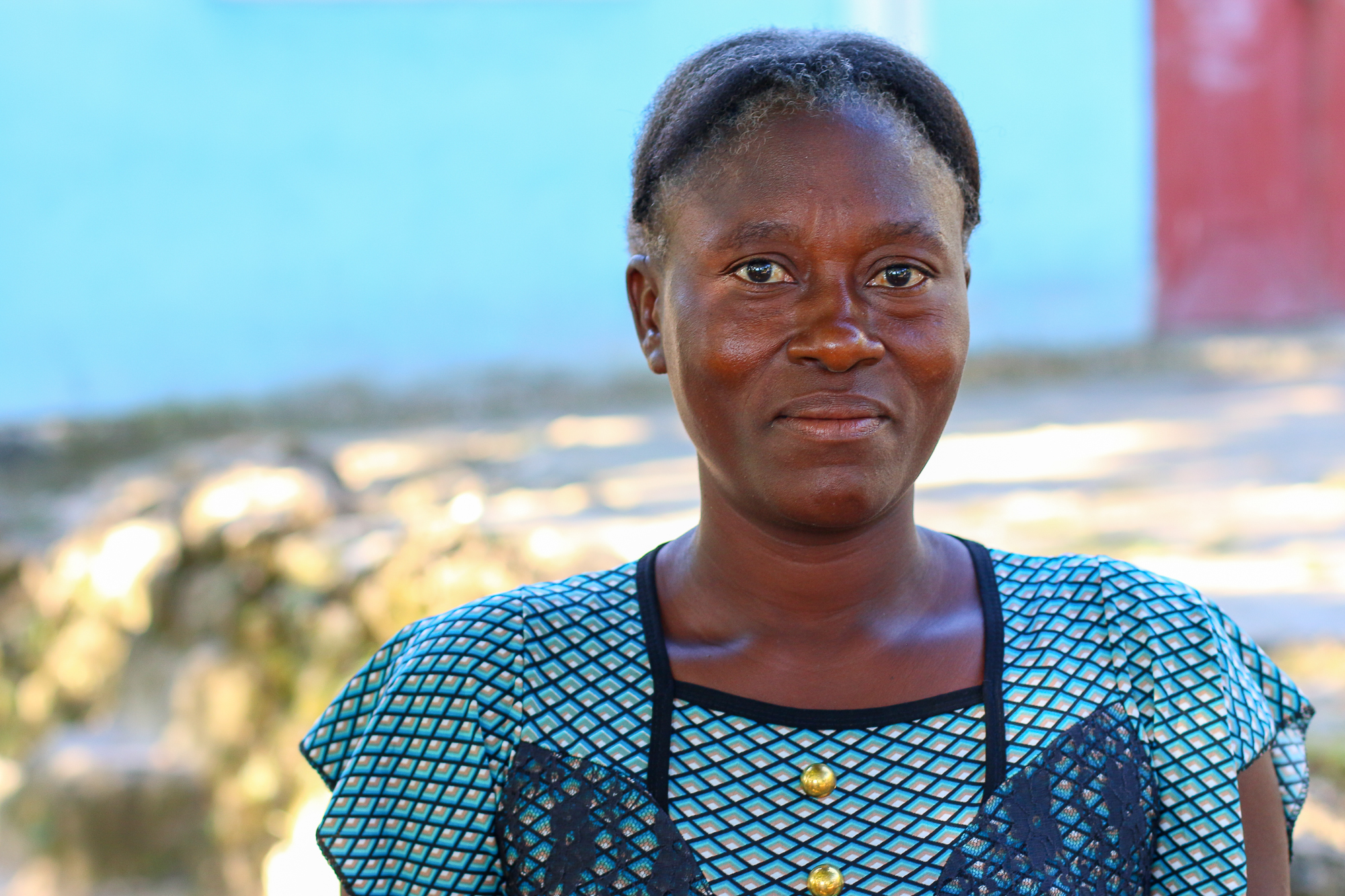 Philemond Remise received staple foods like rice and beans, egg-laying chickens, barbed wire, and training to build soil conservation structures in her garden, all of which helped her start producing food for her family again after Hurricane Matthew.