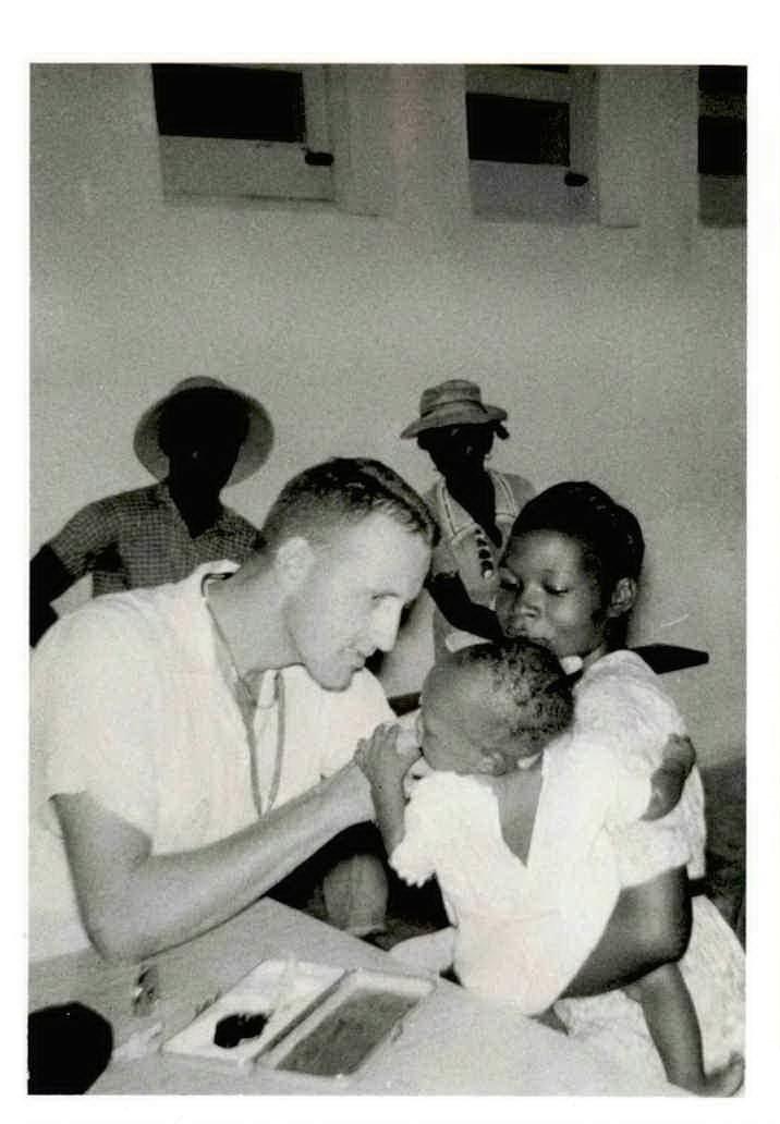 Dr. John Bender examines a baby at Hospital Grande Rivere du Nord.