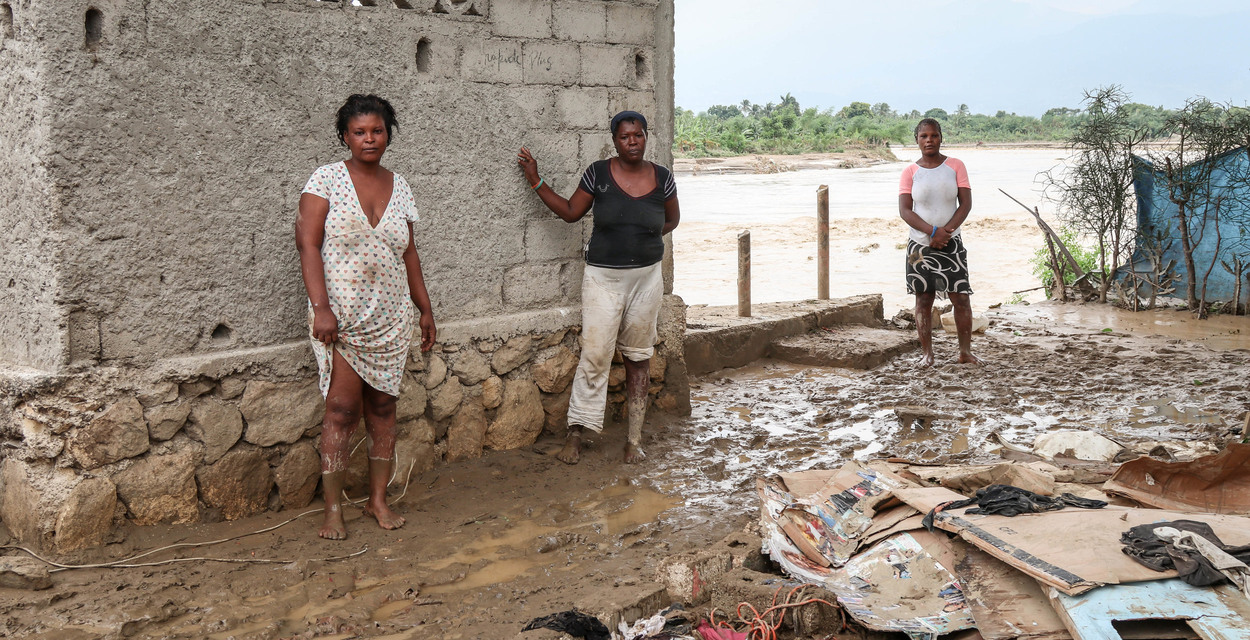 Pictured left to right: Recipients of MCC rapid reponse to relief: Kasandra Lougen, Sarditren Dete, Antovan Enit, from the Voudray community of Cite Soleil, standing where each of their three houses washed away by  Hurricane Matthew .