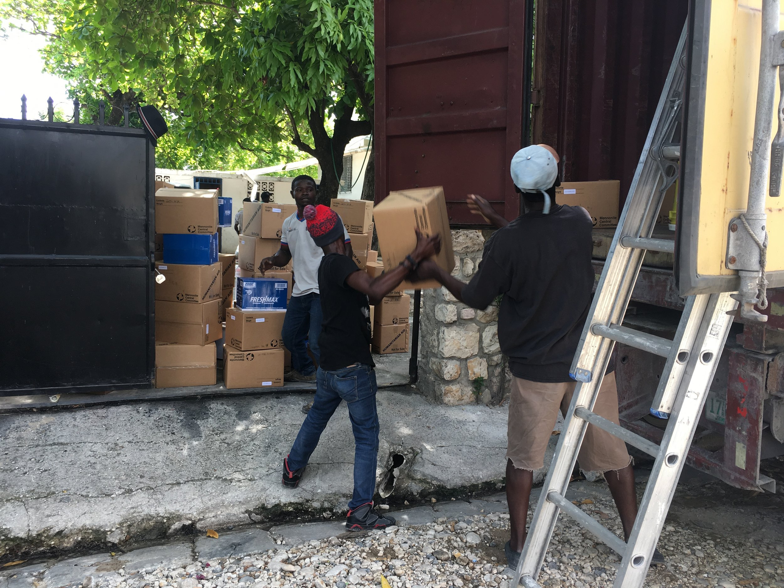 Material resources being unloaded at the MCC office in Port-au-Prince. MCC Photo/Madeline Kreider Carlson