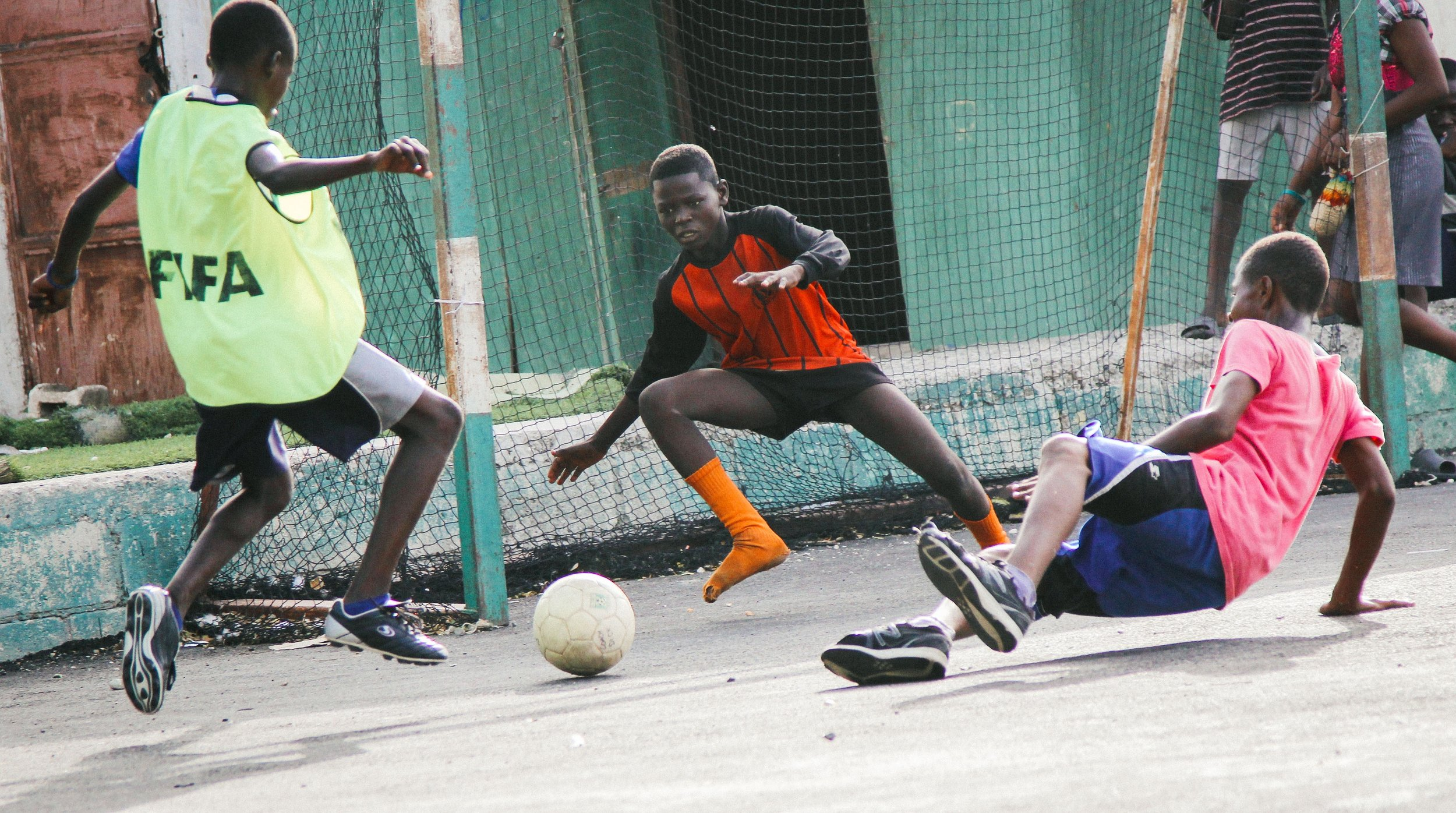 Participants play soccer at the SAKALA community in Cité Soleil.