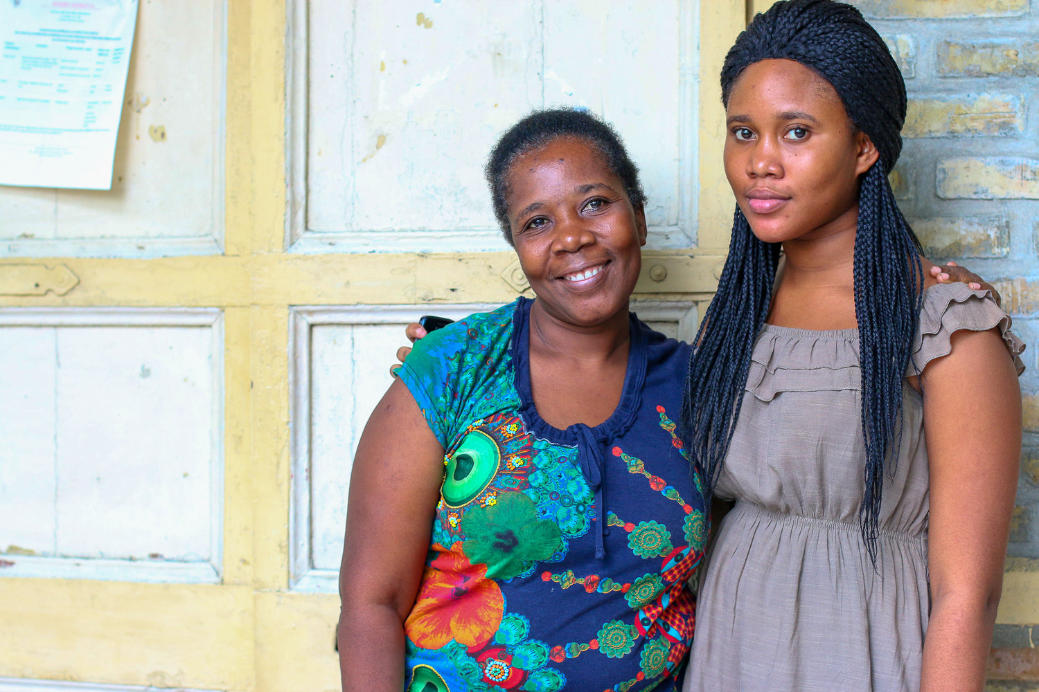 Abigaelle Levasseur (right) with her mother, Manite Levasseur, at SOFA's office in downtown Port-au-Prince.