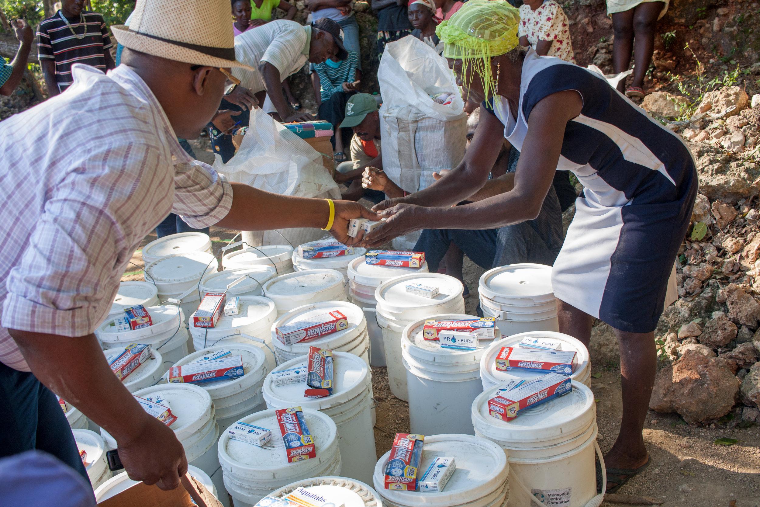 MCC logistics manager Herve Alcinna prepares relief buckets for distribution. MCC Photo/Annalee Giesbrecht