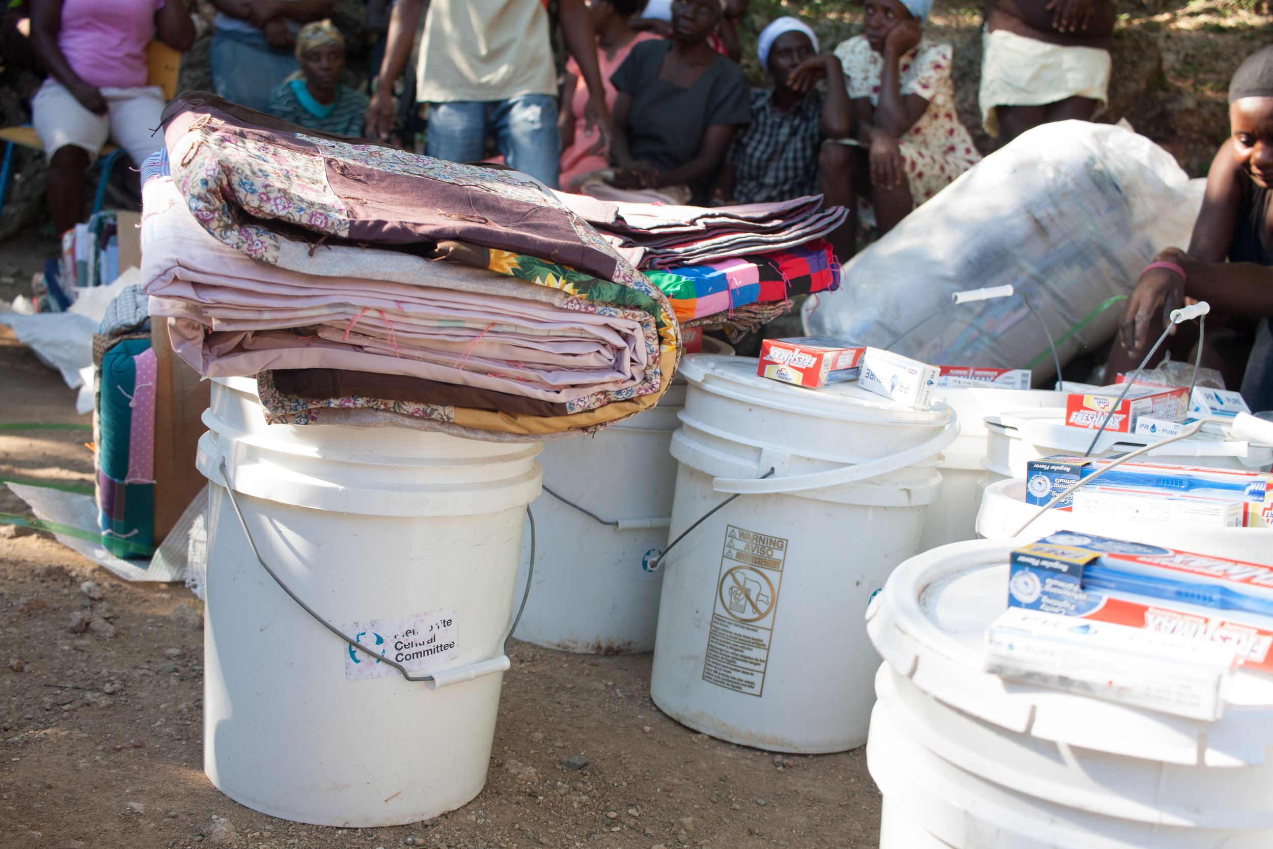 Even in a hot climate like Haiti, comforters can be tremendously useful, providing a soft surface to sleep on if mattresses or other blankets have gotten damp as a result of damaged roofs or walls. MCC Photo/Annalee Giesbrecht