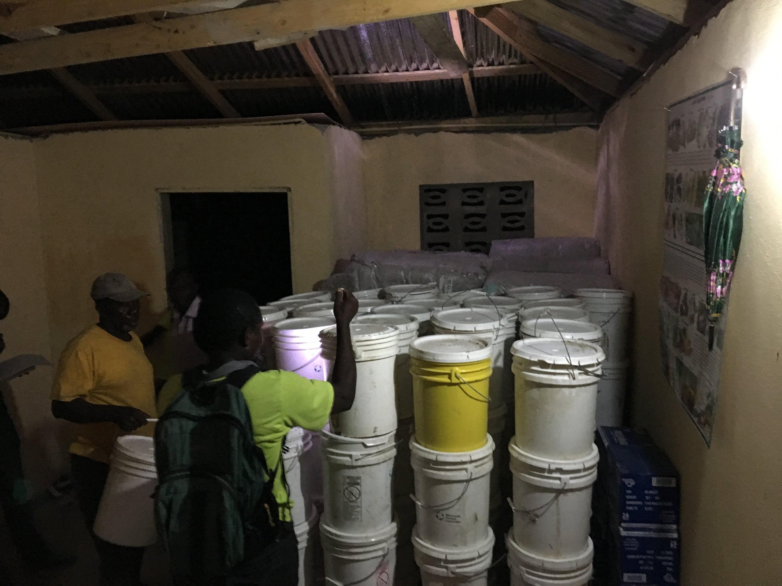 Storing and counting relief buckets at the offices of Church World Service partner AGEHPMDNG. MCC Photo/Annalee Giesbrecht