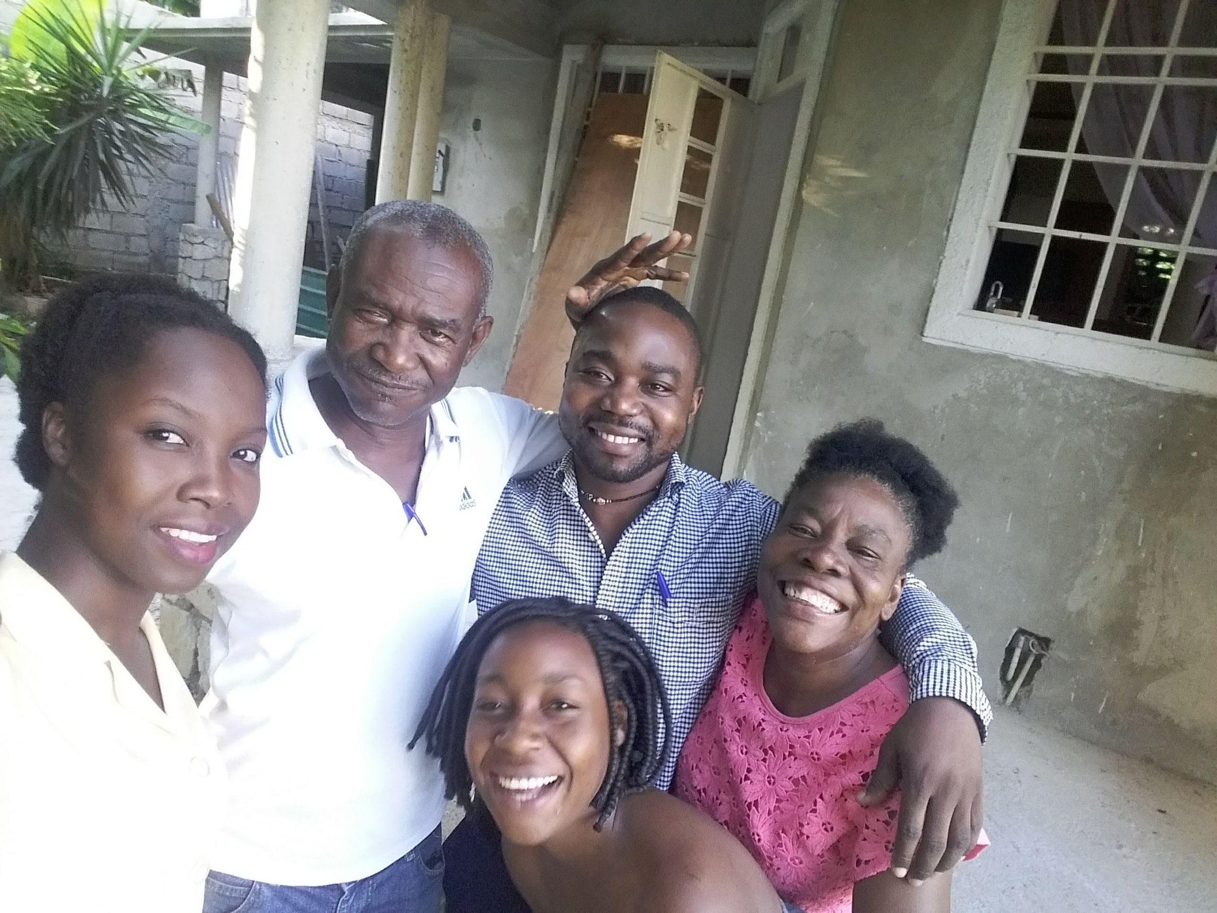 Zua with his Port-au-Prince host family.