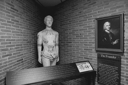 A statue of Bienville showing an example of some of his tattoos on display at Fort Conde museum.