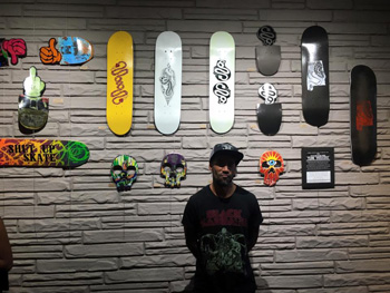 Jewel Cullen, the artist behind the recent Skateboard Art Show to benefit the Flow Intitutive at Serpents of Bienville