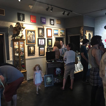 Photo from the recent Skateboard Art Show to benefit the Flow Intitutive at Serpents of Bienville