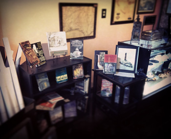 Photo of the inside of the new Serpents of Bienville Space, a shot of just some of the books available for you to take home.  Books range from ghost stories, southern folklore, and local history.