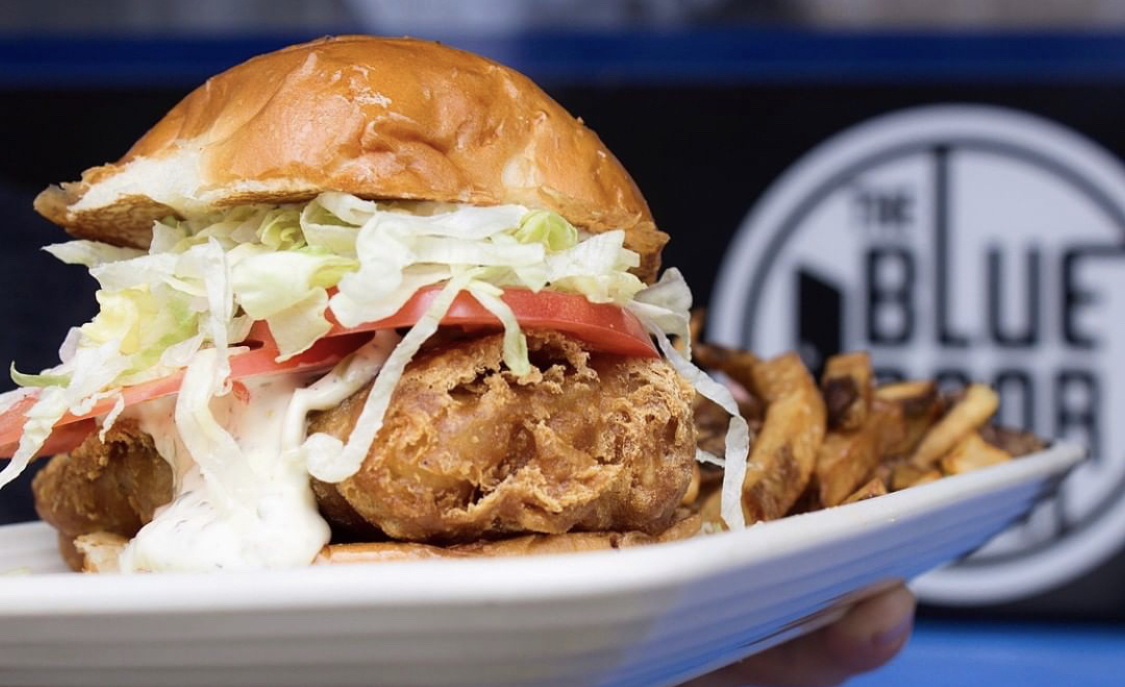 Fishwich Special - cod • American cheese • shredded lettuce • tomato • house tartar sauce ...comes with a side of fries or tots!