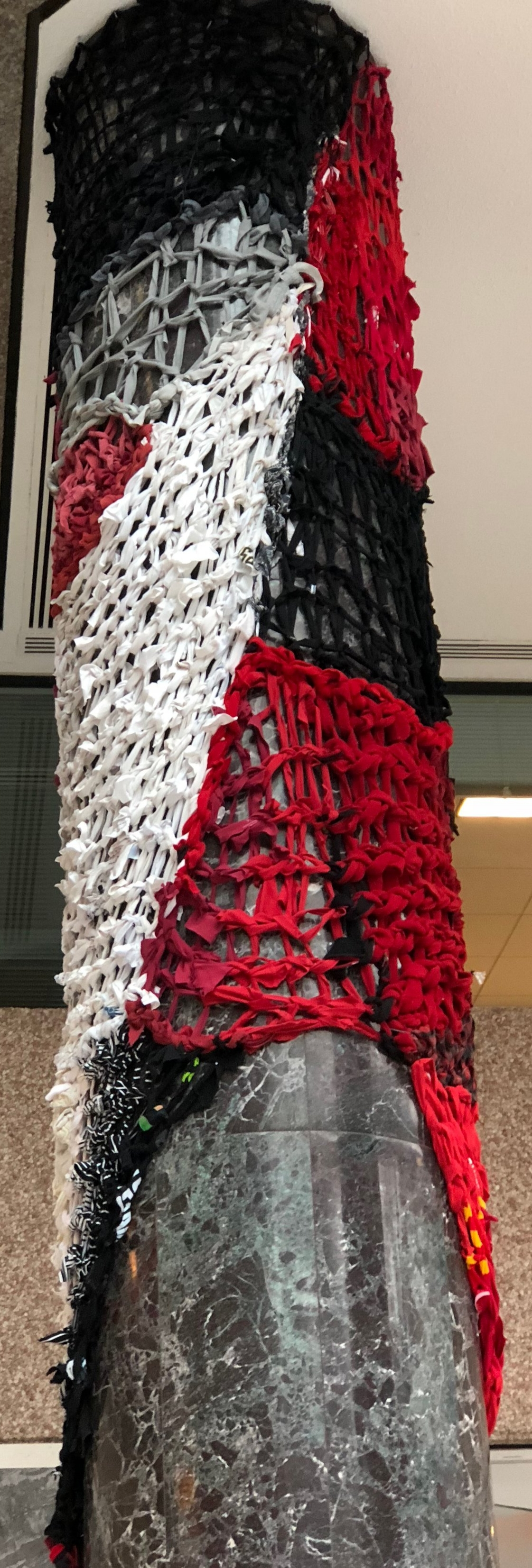 recycled textiles, paracord  19' height x 11' circumference  SOLD