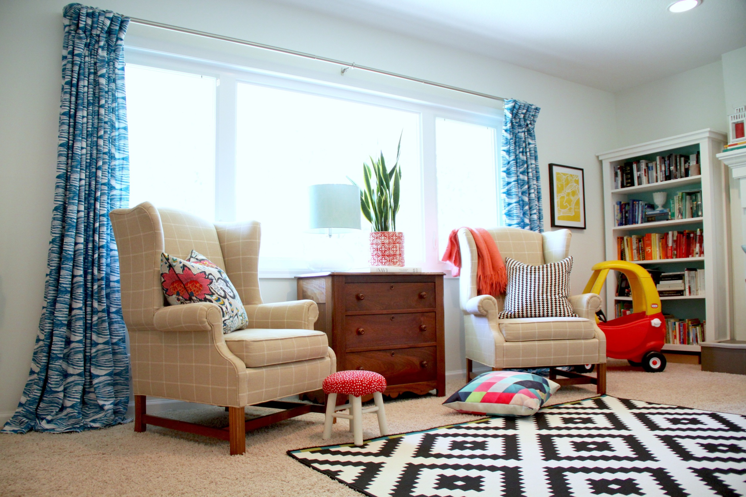 Living Room with DIY Pinch Pleat Curtains and White Walls