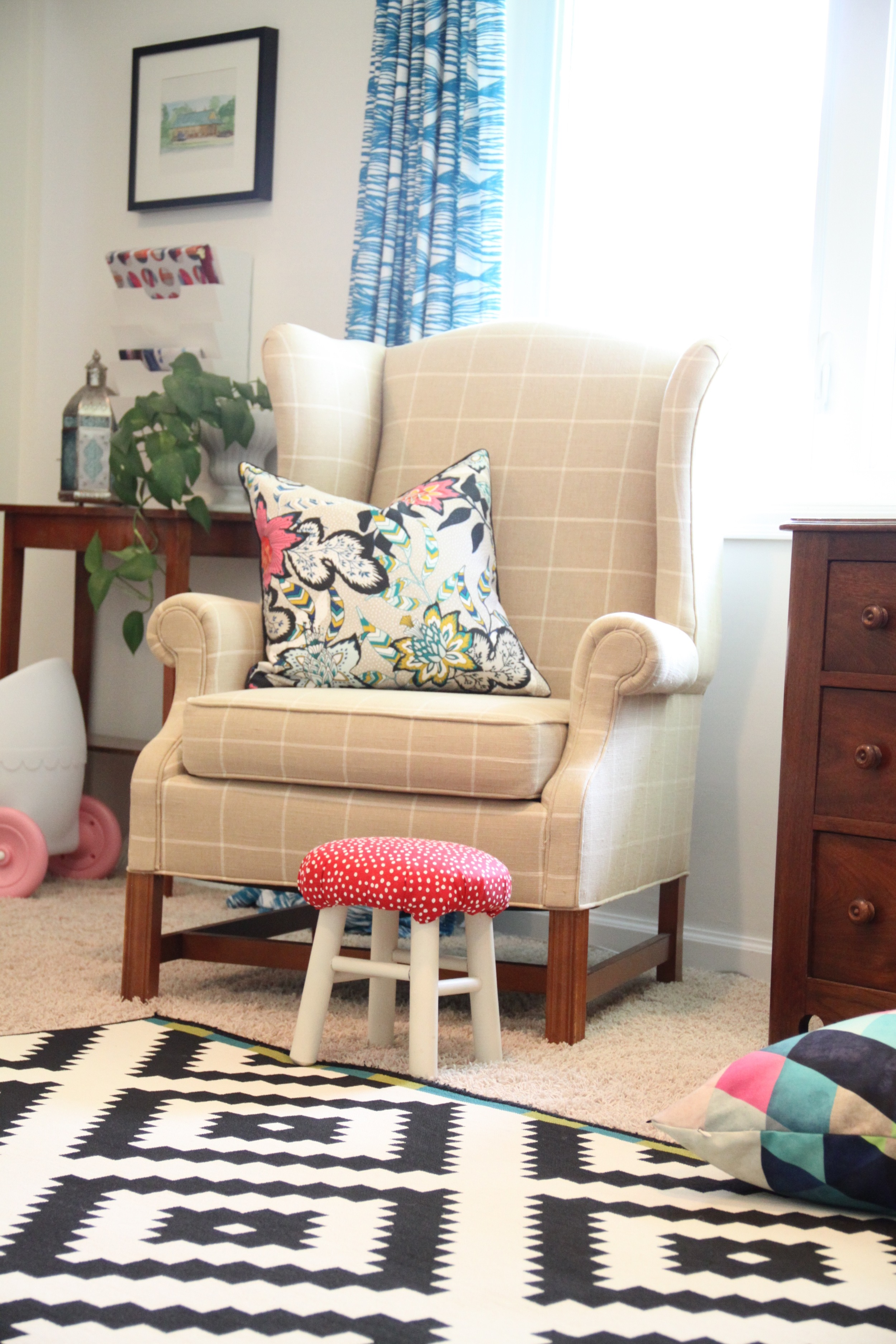 Living Room with Stool and Wingback Chairs
