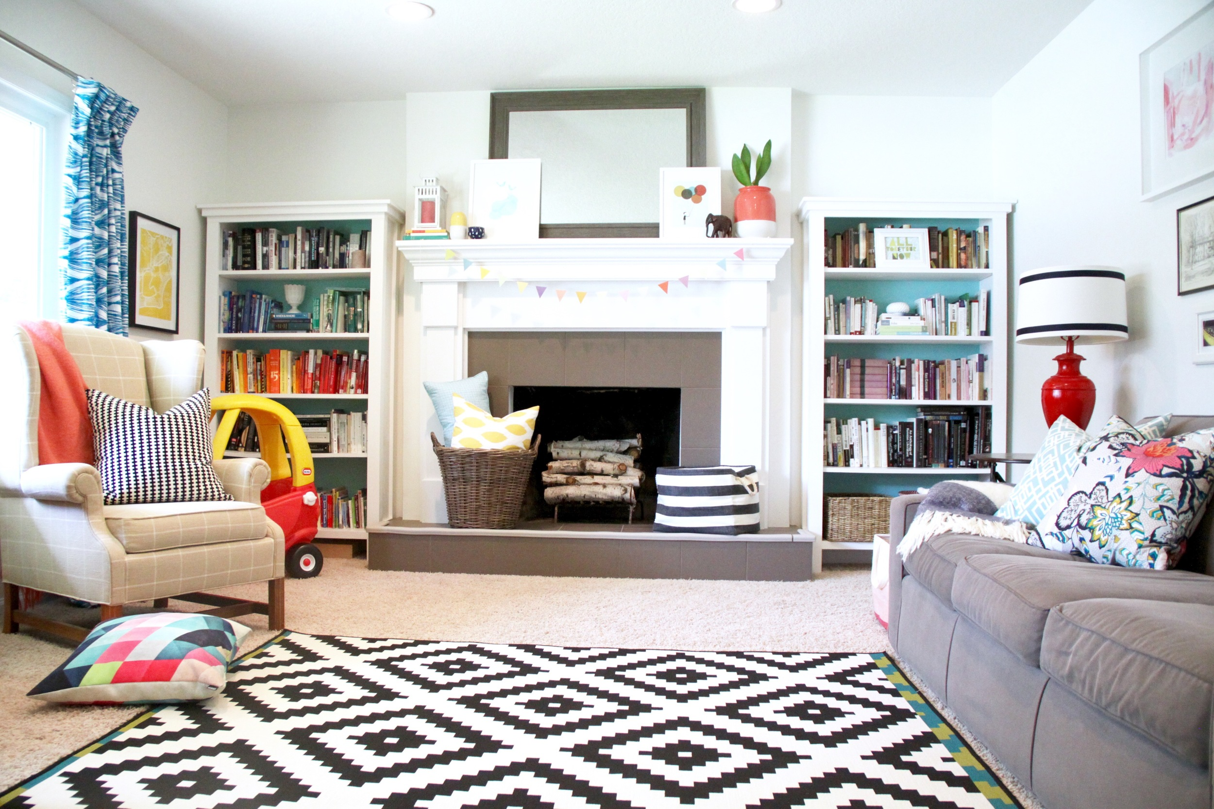 Living Room with White Mantel and DIY Bookshelves