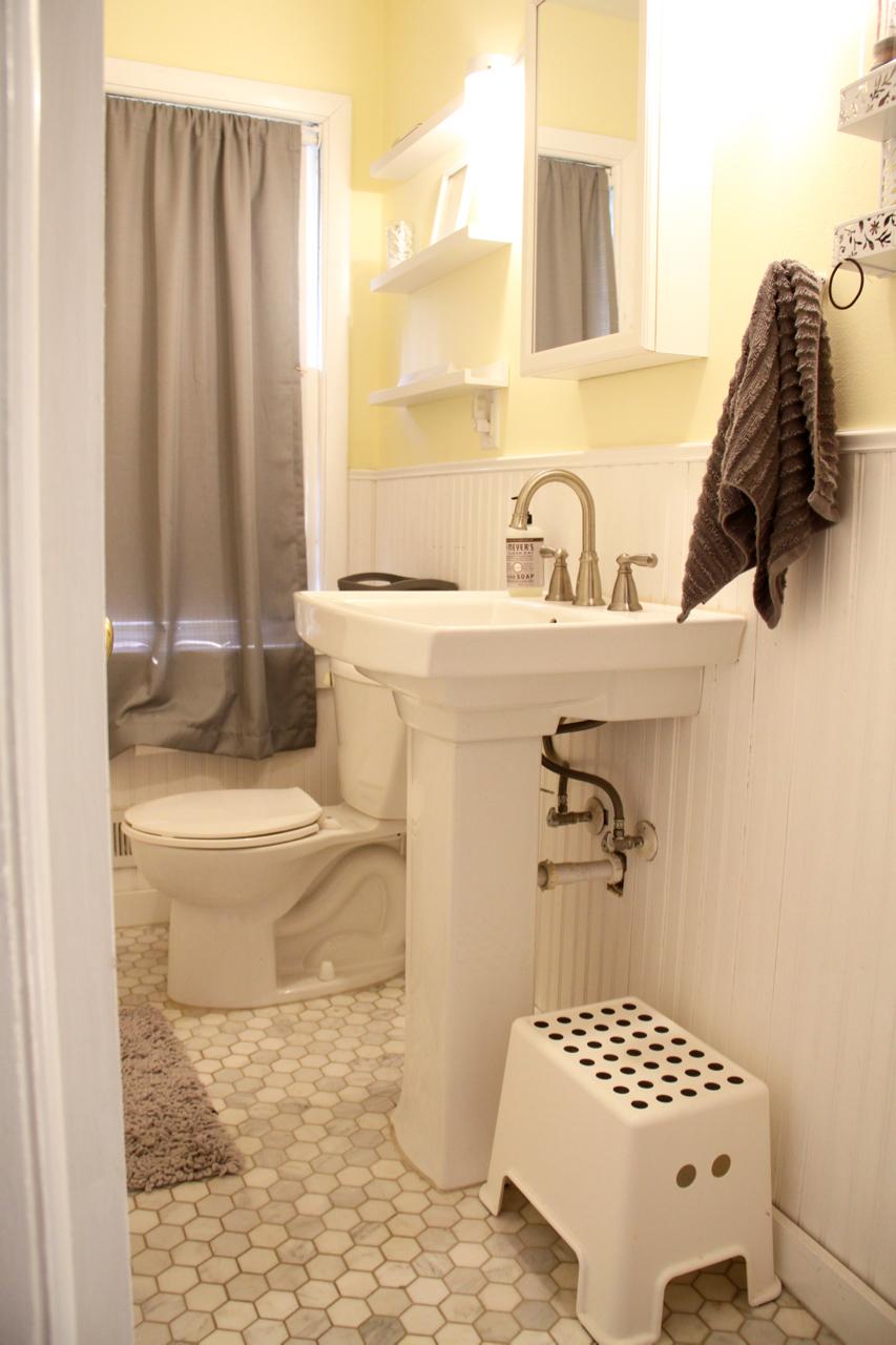Bathroom with Marble Tile, Pedestal Sink