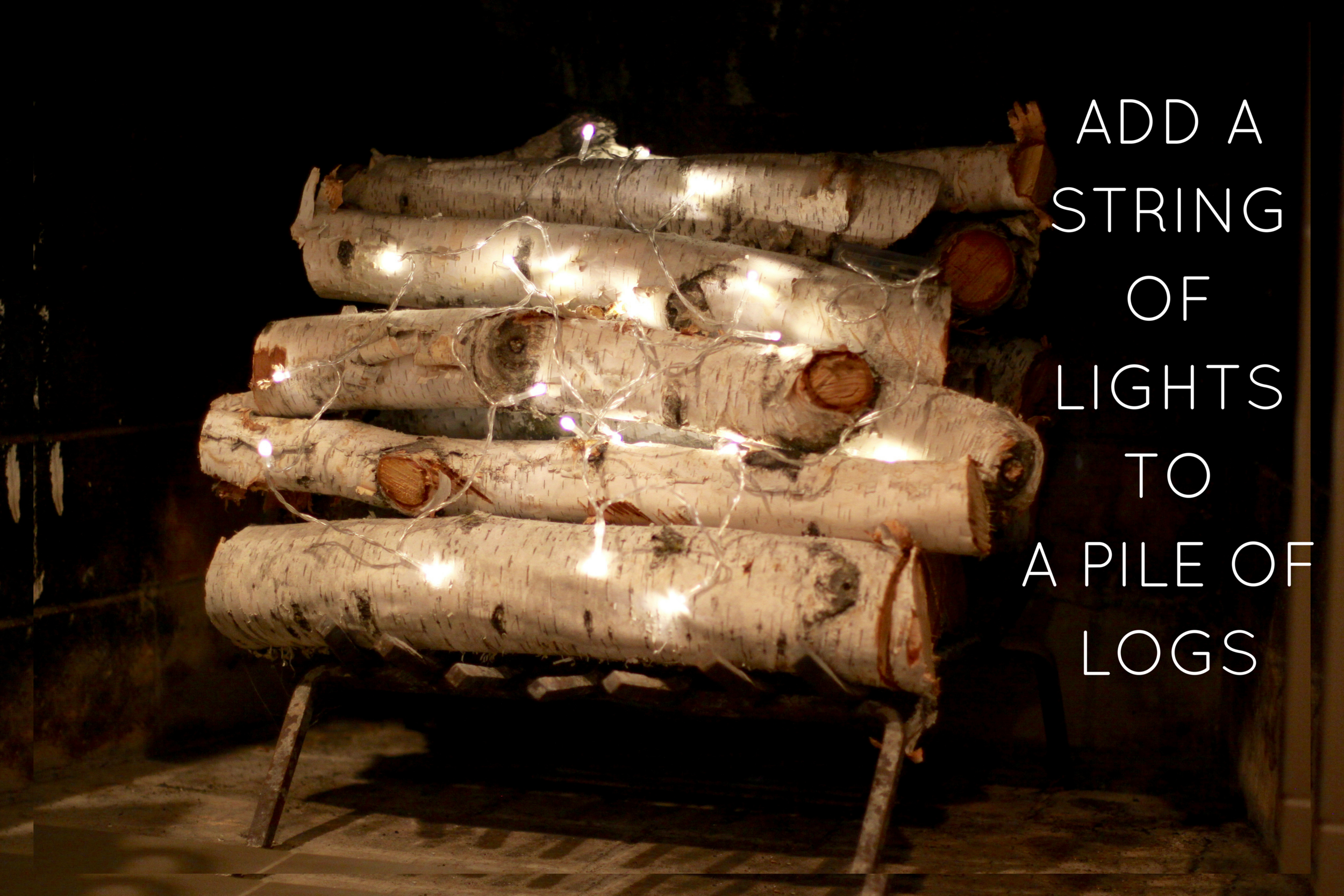 Easy Fireplace Idea—Battery-Operated Strand Lights Wrapped around Logs