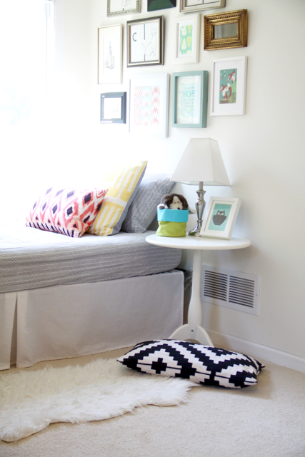 Nursery Nook with White Walls and Bright Colors
