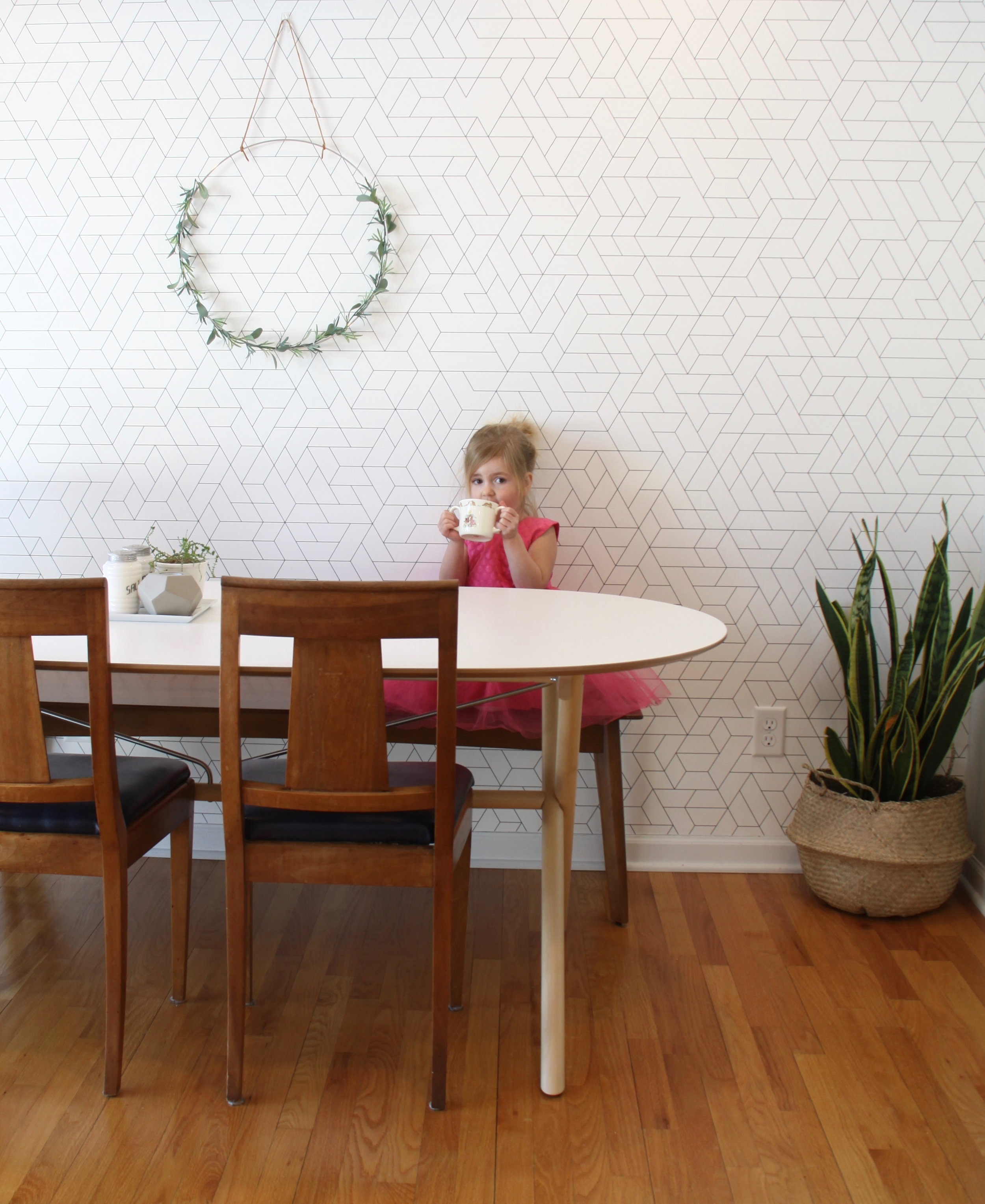 Mid century dining room with wallpaper