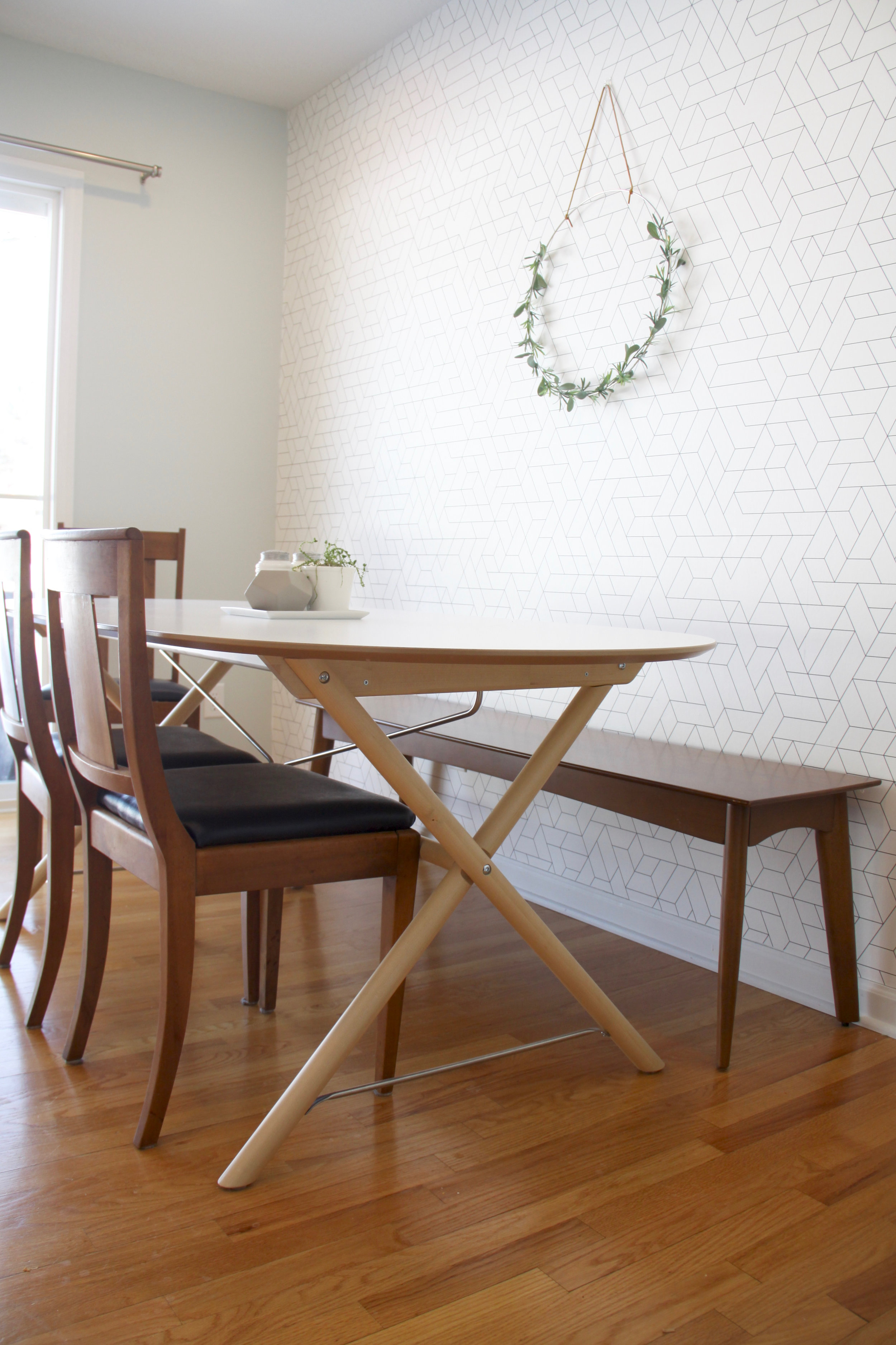 Mid century dining table with graphic wallpaper IKEA SLAHULT