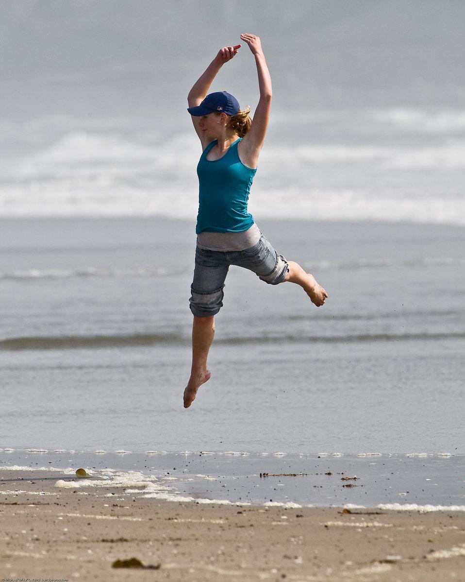 A girl jumping on the beach.jpg