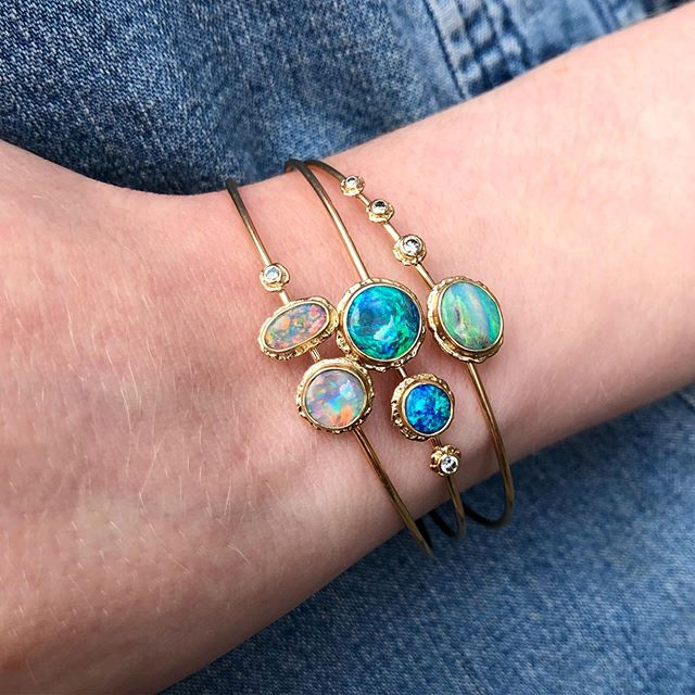 Stack these opal and diamond bangles ✨ Available @trabertgoldsmiths #blackopals #gold #madebyhand