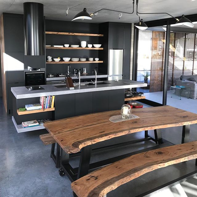 Marri Slab Table & Bench Seats | Kitchen features Black Matt Laminate | Marri Shelving | Concrete Benchtop  #dunsborough #dunsboroughwoodworks #australia #furniture #kitchen #kitcheninspo #design #home #interiordesign #homedecor #bespoke #custom #cabinetry #interior #westernaustralia #perth #dinjngtable #marri #concrete #blackmatt