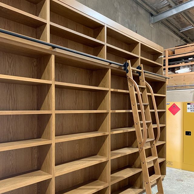 Stained American Oak Library Wall | Quiet Glide Ladder  #dunsborough #dunsboroughwoodworks #australia #furniture #library #books #bookstorage #storage #design #home #interiordesign #homedecor #bespoke #custom #cabinetry #interior #westernaustralia #perth #americanoak #quietglide #southwest #yallingup