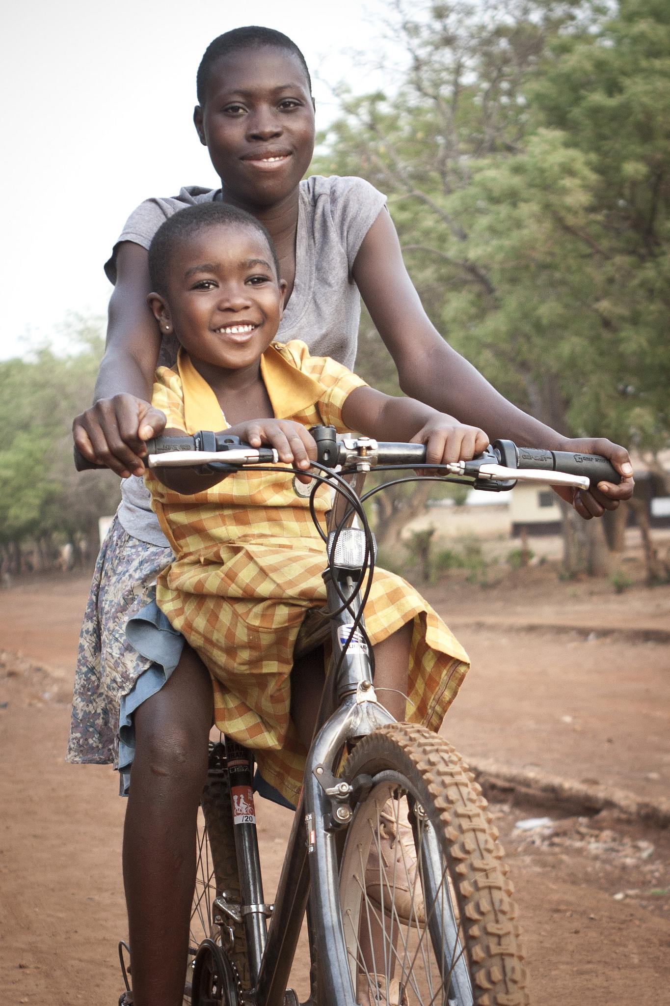 Recycle charity girl on bike