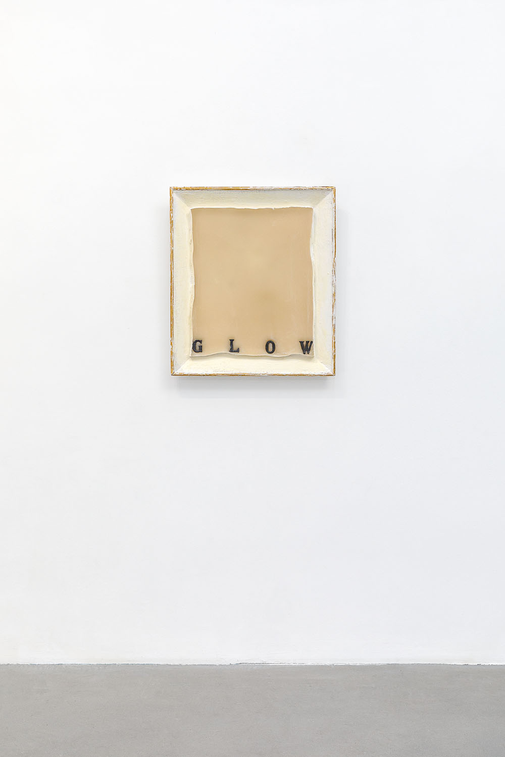 GLOW, 2018  Wax, vintage frame, lead word 70 x 60 cm  Courtesy the artist and Rabouan Moussion Gallery Photo Credit : Romain Darnaud
