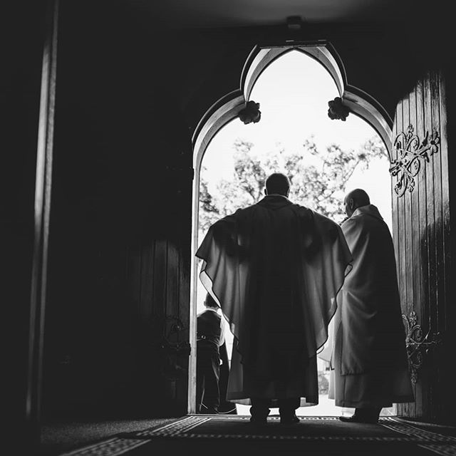This photo terrifies me with its bat like religious undertones and skewed framing ! An impatient priest awaits the bride. Thoughts below.