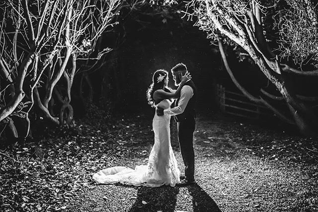 Taken in the pitch black of night with my trusty off camera flashes. I used one to backlight the bride and groom and the other to illuminate the tree branches. The only limitation is your imagination.
