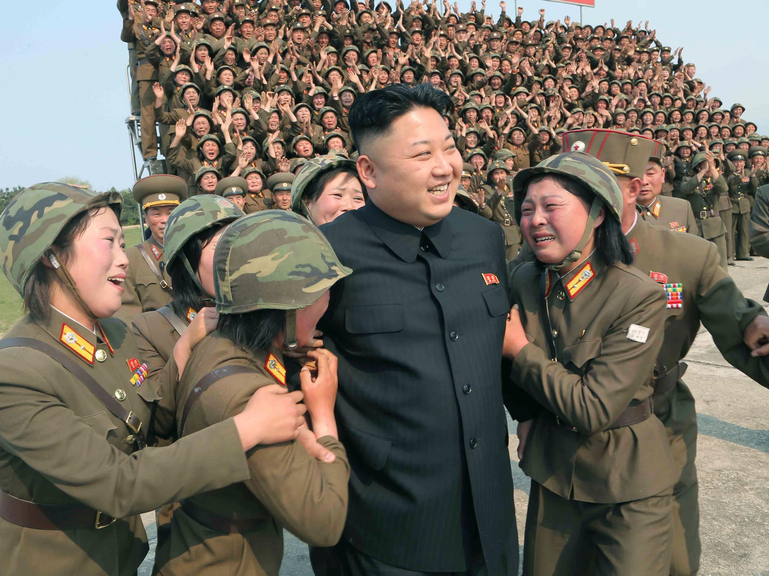 North Korean leader Kim Jong Un greets a women's subunit during a rocket launching drill Reuters/KCNA KCNA