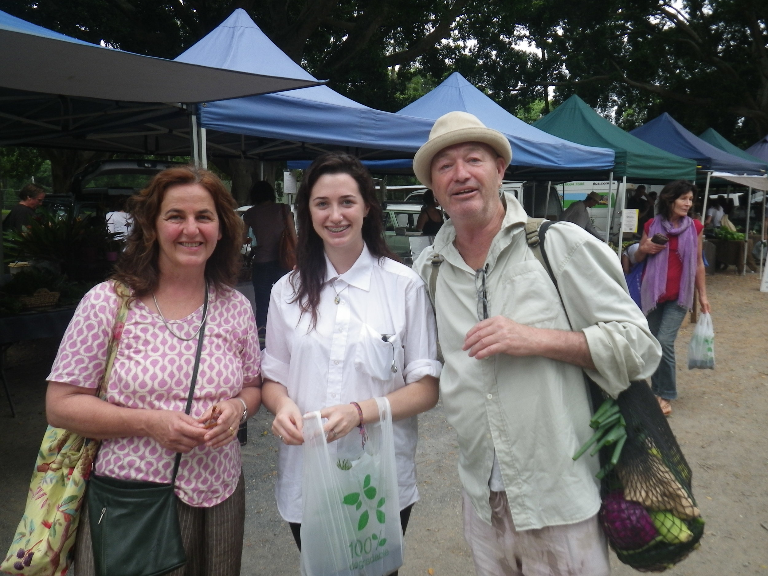 Kate Veitch, Lily and Vince Lovegrove, at the Mullumbimby Farmers Market on 11/11/11