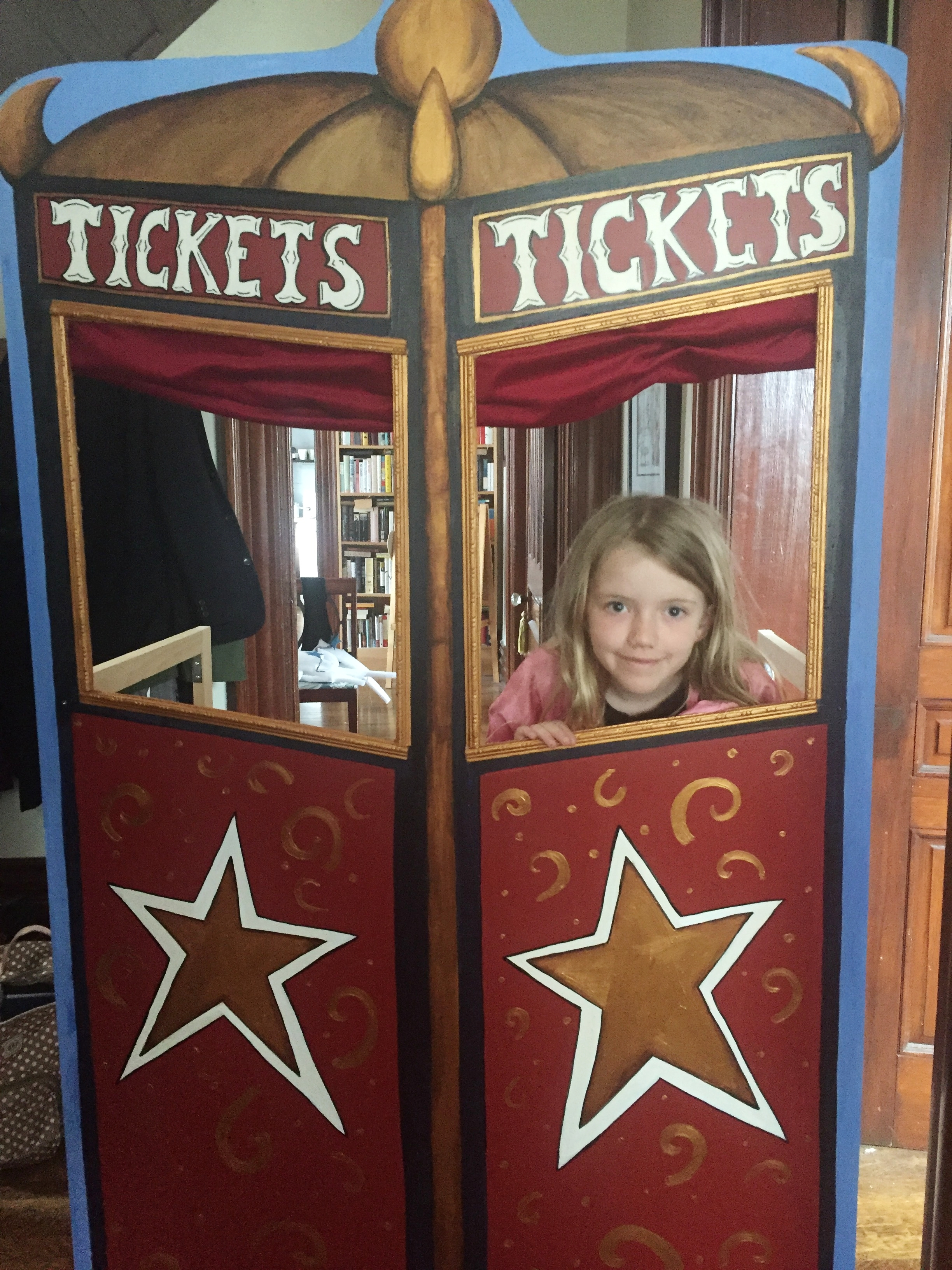 Ticket booth with cutie pie kid.