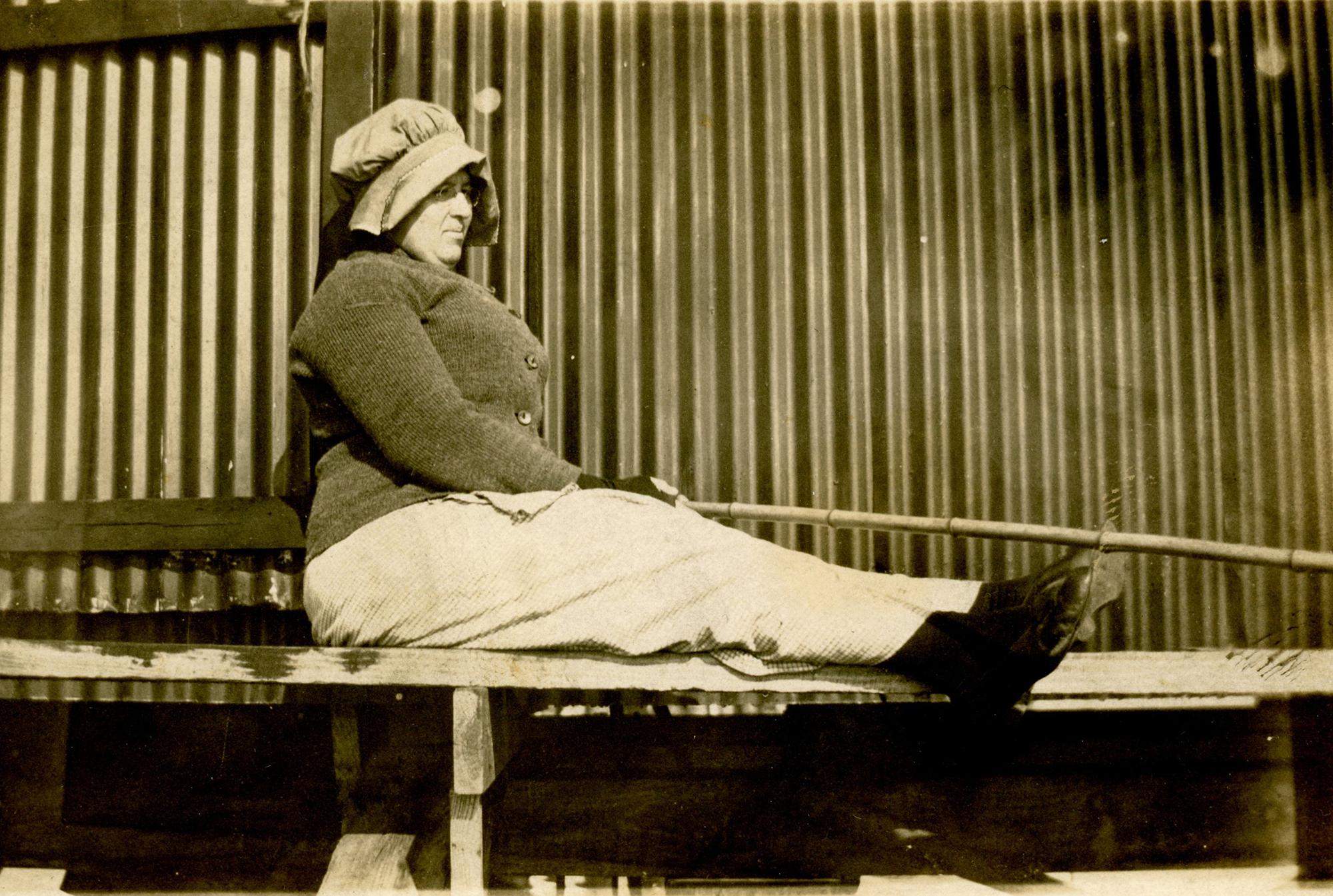 Real photo postcard, woman fishing off pier, ca. 1915
