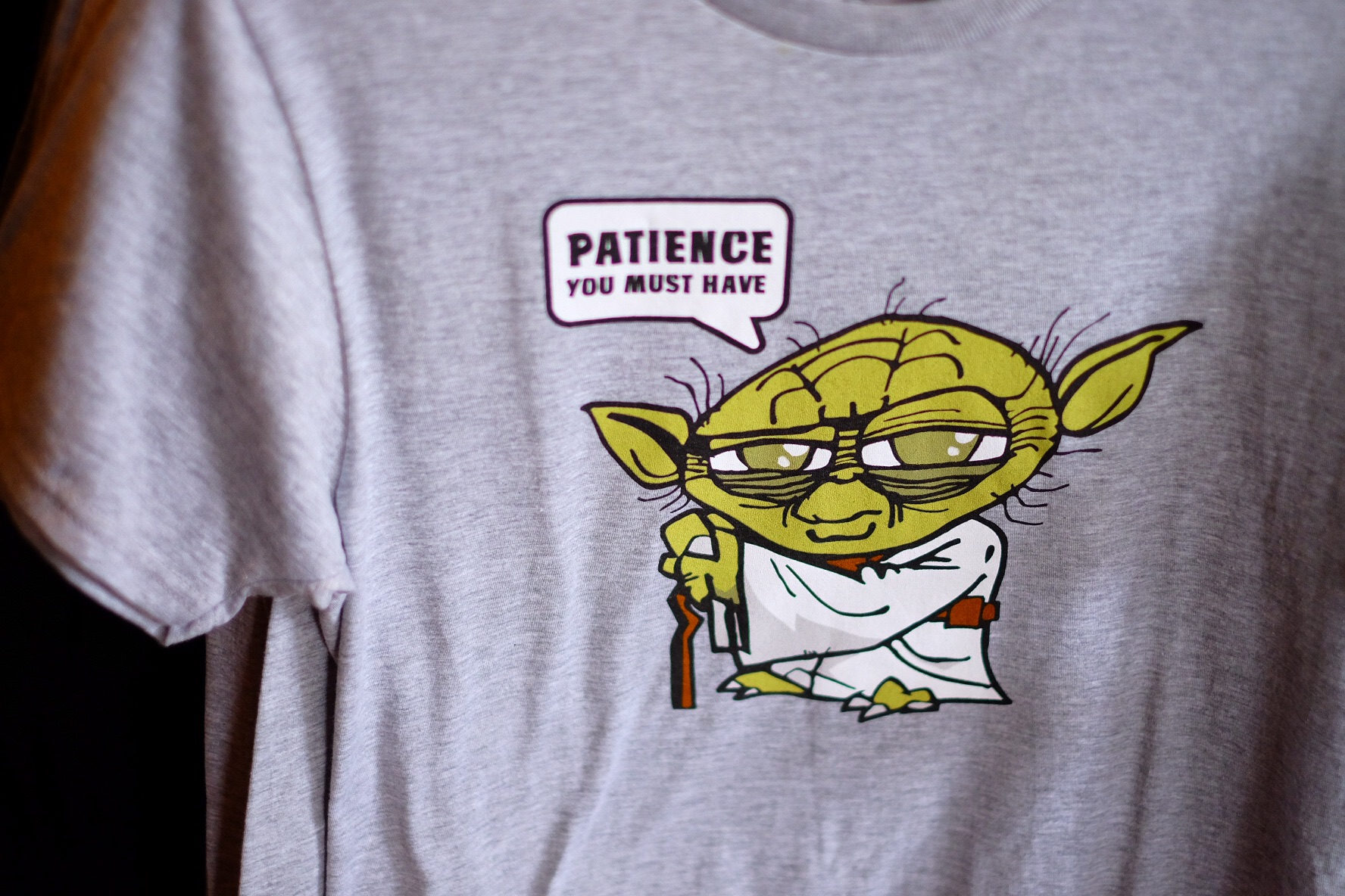 """Colin may have remained chill and calm this morning when we announced Disney, however he has very short patience. So we have told him """"patience"""" is his word for this trip. Unfortunately this shirt was only in adult size."""