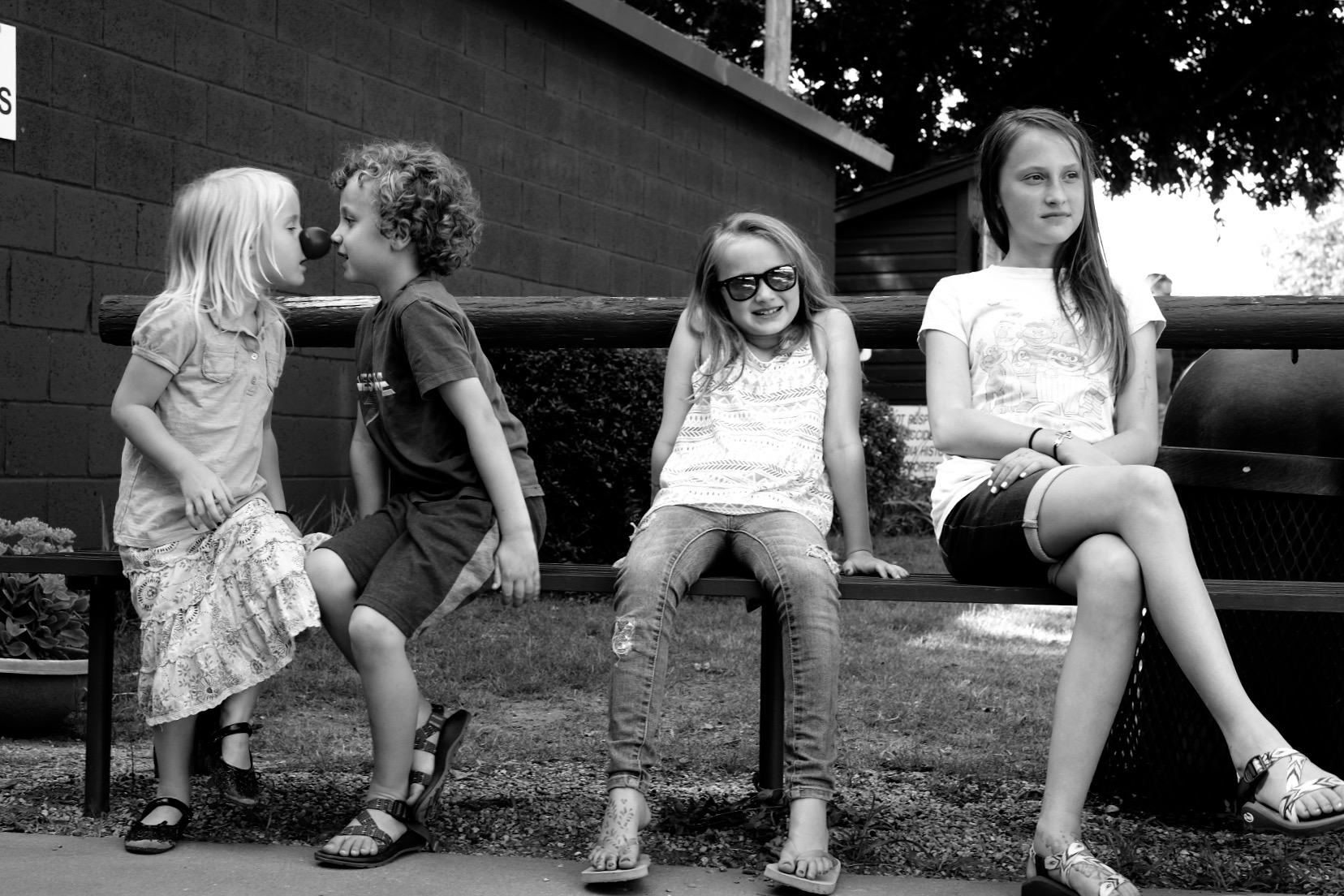 """My kiddos waiting on me to photograph """"just one more thing""""."""
