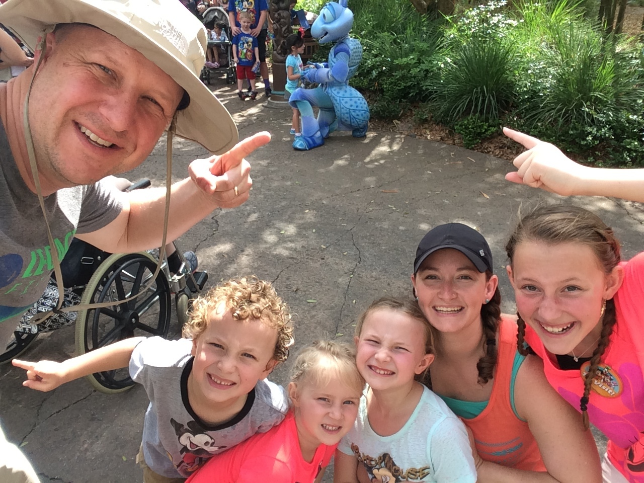 Family selfies! We decided that waiting in line to meet the characters was just our thing, but if we saw one out and about we would take a family selfie with the character in the background.