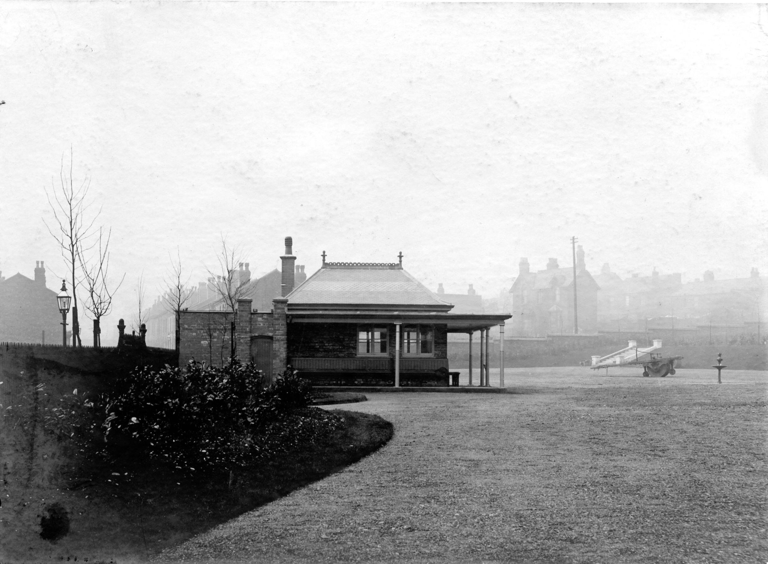 THE REC 1909 at the entrance the low building was the Park Keepers Hut with seating around outside, with a Gents lavatory one side and a Ladies on the other. Steps to the bowling lawn on the right towards the back. Houses along Musgrave Road on the left and Talbot Street on the right.