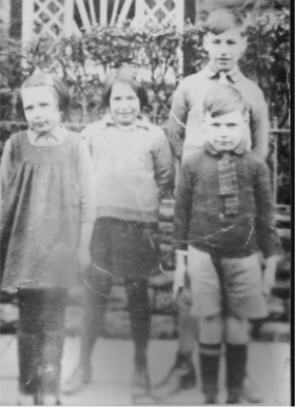 FOUR BROOKFIELDS EVACUEES  A photo of evacuees from Brookfields during WW2 outside the house in the village of 'YNYSYBWL' in Wales. From left to right are June Day; June Millichamp, Raymond Millichamp and 'Sunny' Day.  Photo and information supplied by June King.