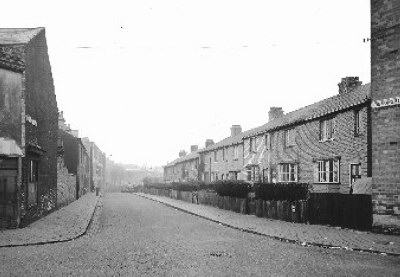 View looking down Devonshire Avenue from the junction of Devonshire Street towards Musgrave Road with Tommy Harpers shop on left. Samuel Groves Ltd is at the far end.