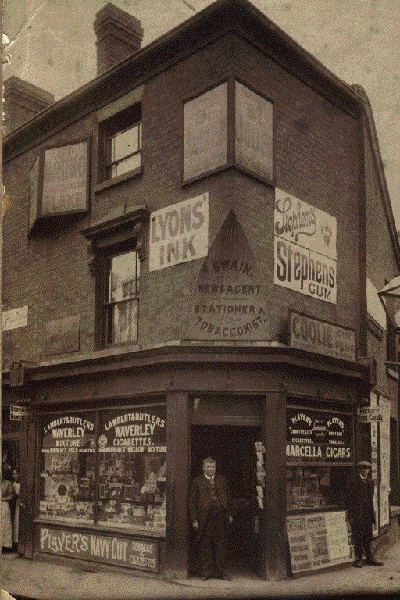 Tom Swain, outside his newsagents and tobacconist shop on the corner of Hingeston Street and George Street West. 1914