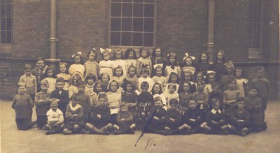 Nellie Foster fourth in from right with ink on face at Ellen Street school 1920s.